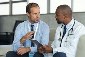 Doctor in conversation with pharmaceutical representative